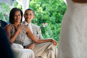 Barack_and_Michelle_Obama_watching_a_wedding-600x400